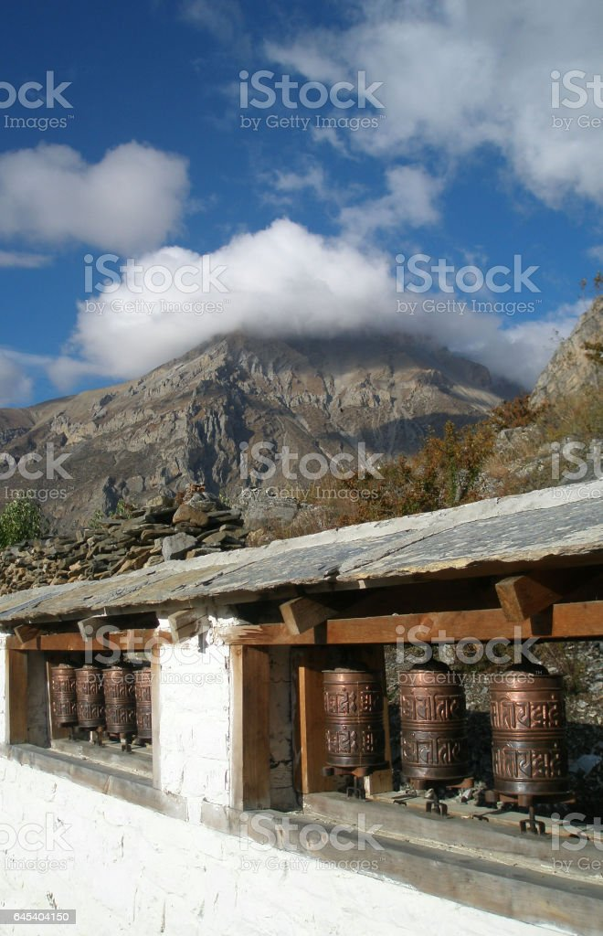 Old Prayer Wheels near village Ranipauwa, Mustang district, Nepal stock photo
