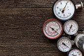 Old pressure gauge on wood table