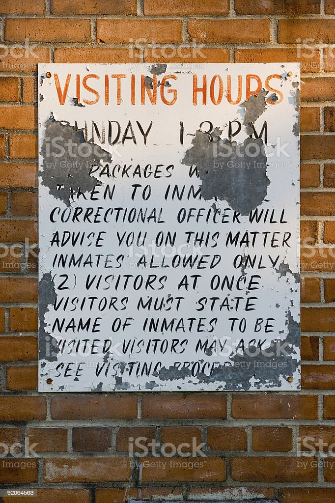 Old Prison Visiting Hours sign stock photo