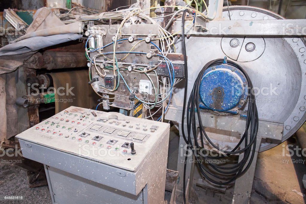 old production machine. old manufactory. fragment of the industrial machine stock photo