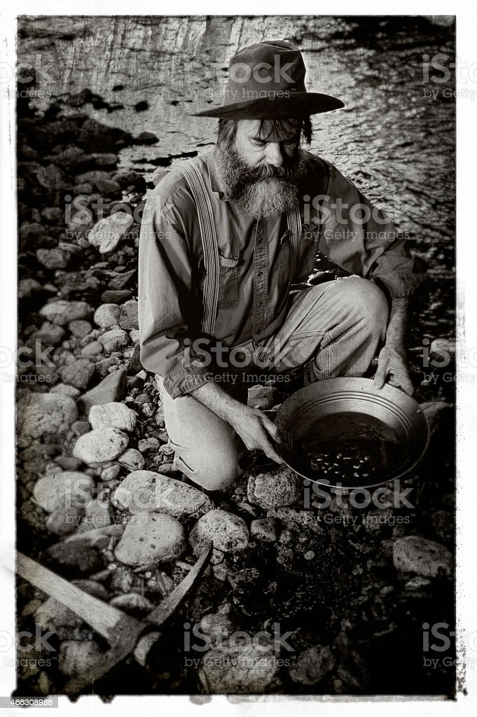 Old Prospector Panning For Gold stock photo