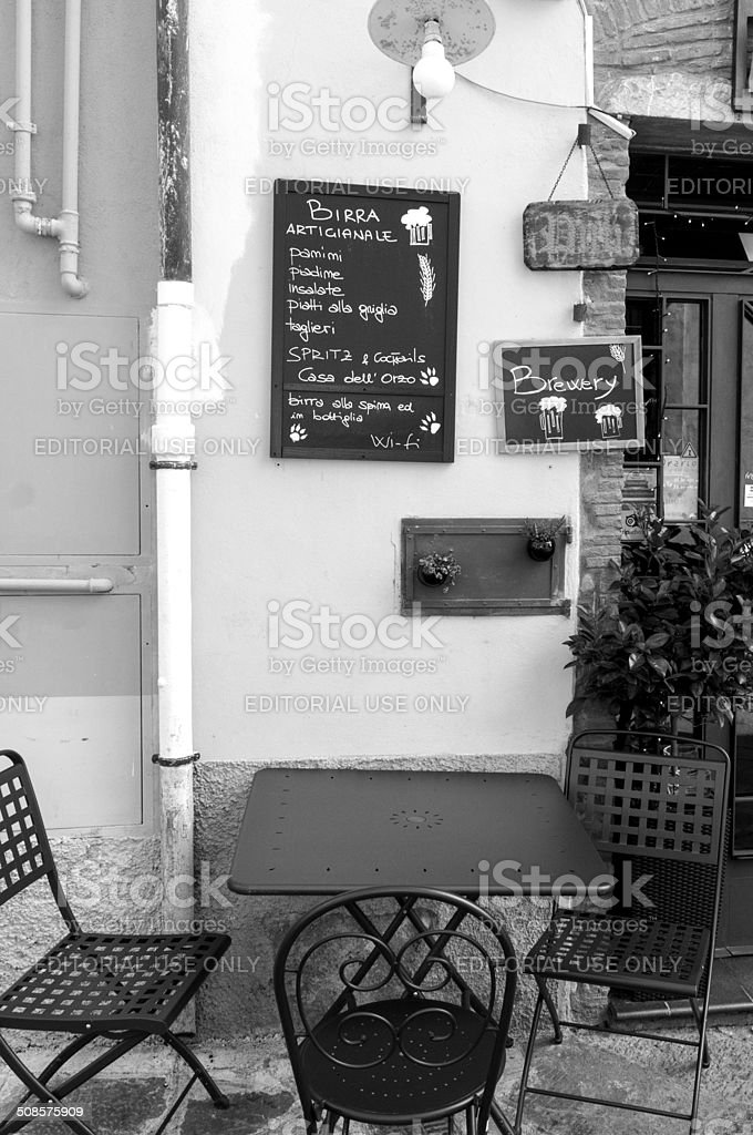 Old pub outdoor in Tuscany. BW image stock photo