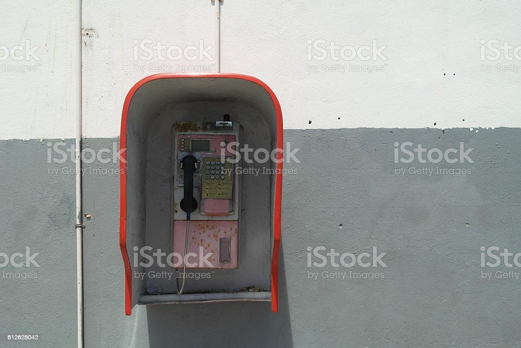 Old public payphone on Praslin island - Seychelles stock photo