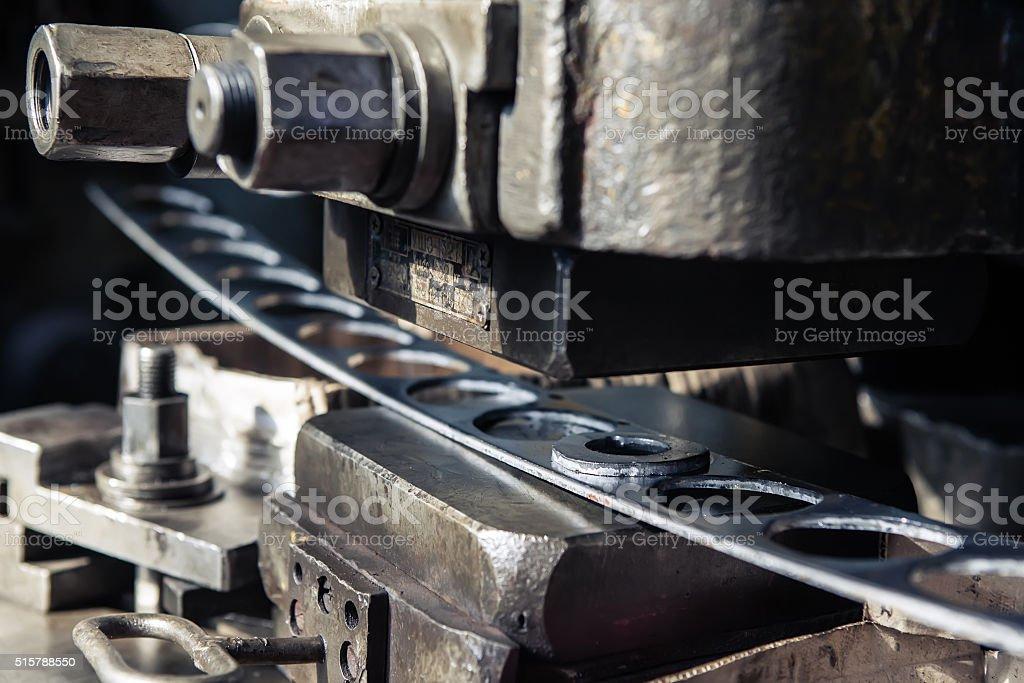 Old punching machine closeup. stock photo