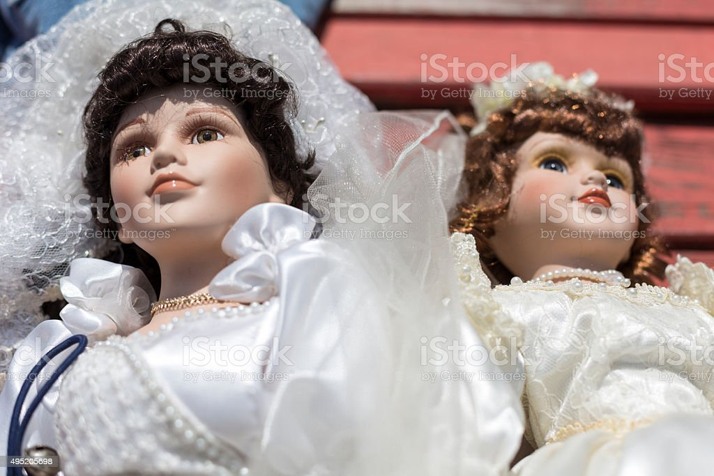 old puppet with wedding dress on a flea market stock photo