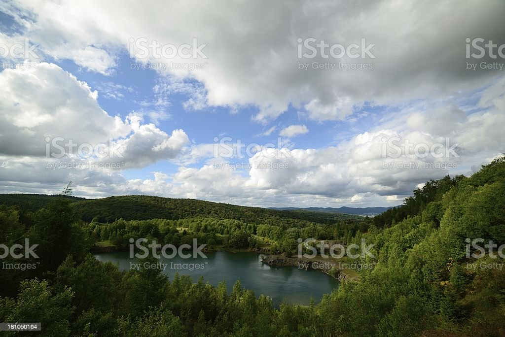 old quarry with a pond royalty-free stock photo