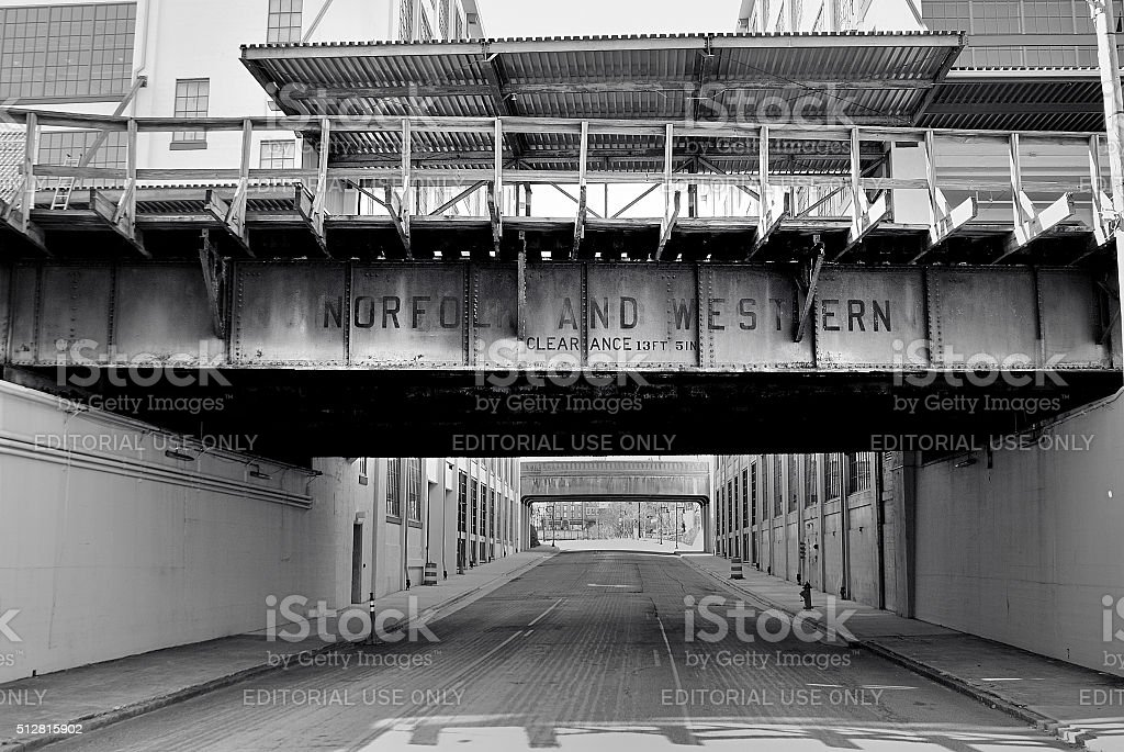 Old railroad bridge crossing old part of downtown stock photo