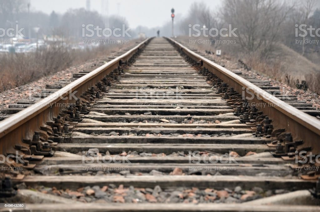 Old railroad tracks with wooden sleepers. stock photo