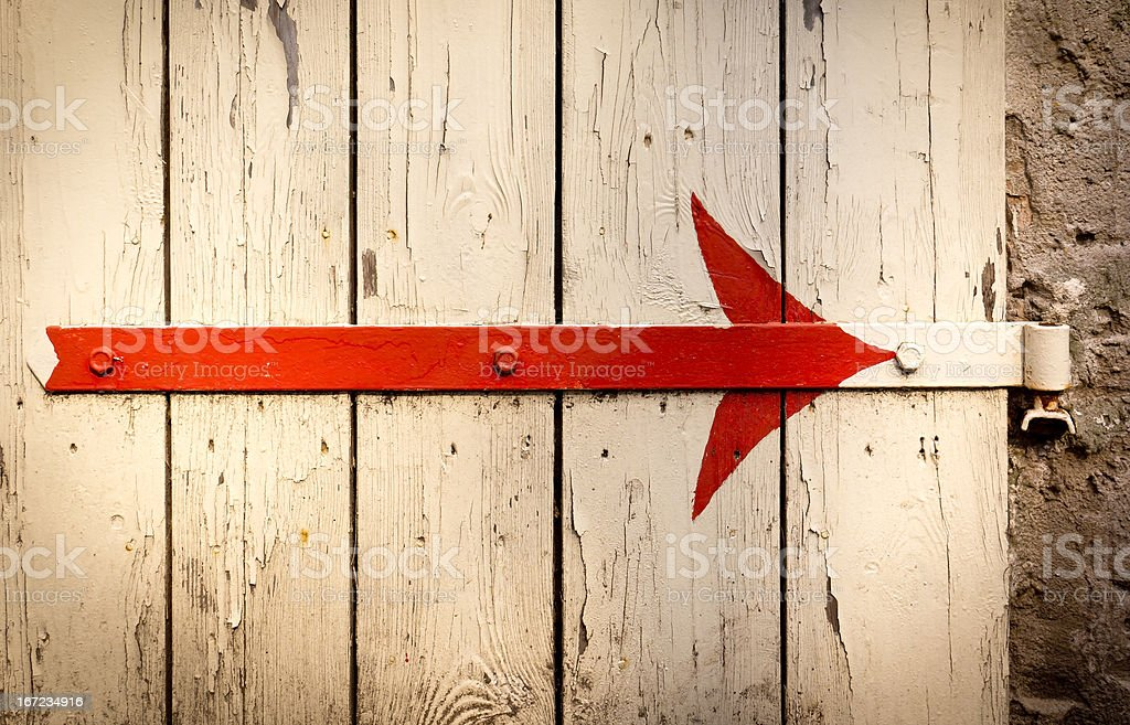 Old red arrow sign stock photo