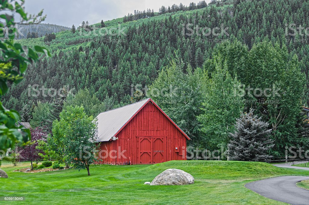 Old Red Barn in the Mountains stock photo