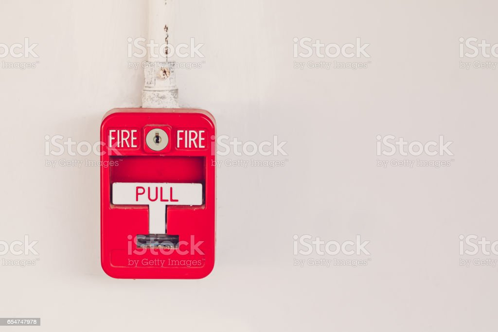 Old red box fire alarm  isolated on white background stock photo