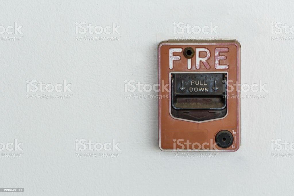 Old red box fire alarm on cement wall stock photo
