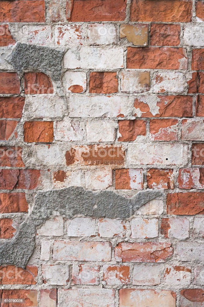 Old red brick wall with white plaster texture background stock photo