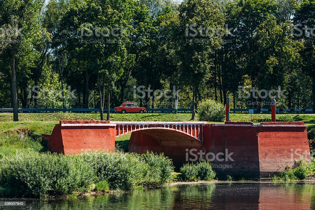 Old red bridge (1927) in the city Dobrush, Belarus stock photo