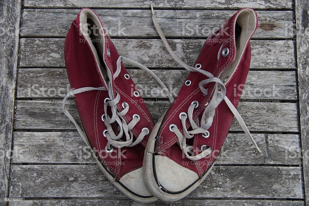 Old red canvas shoes stock photo