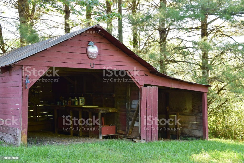 Old red garage from front stock photo