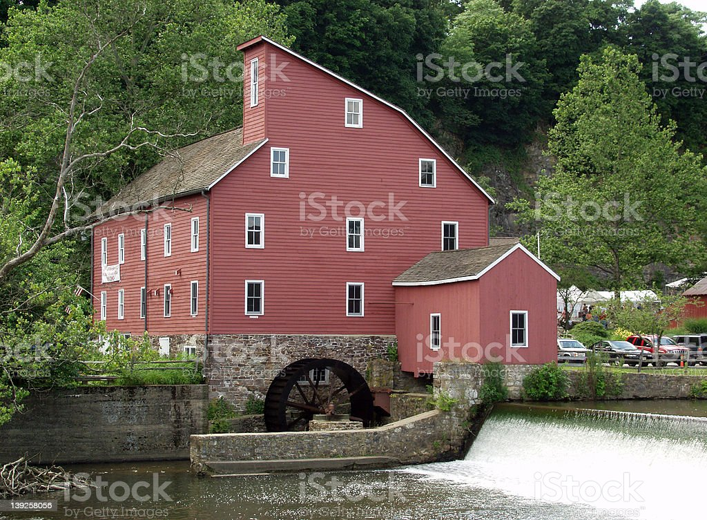 Old Red Mill with Waterwheel stock photo