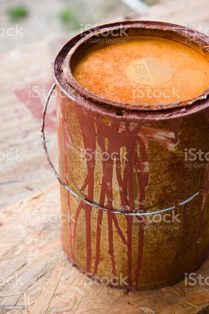 Old red paint bucket full of rust royalty-free stock photo