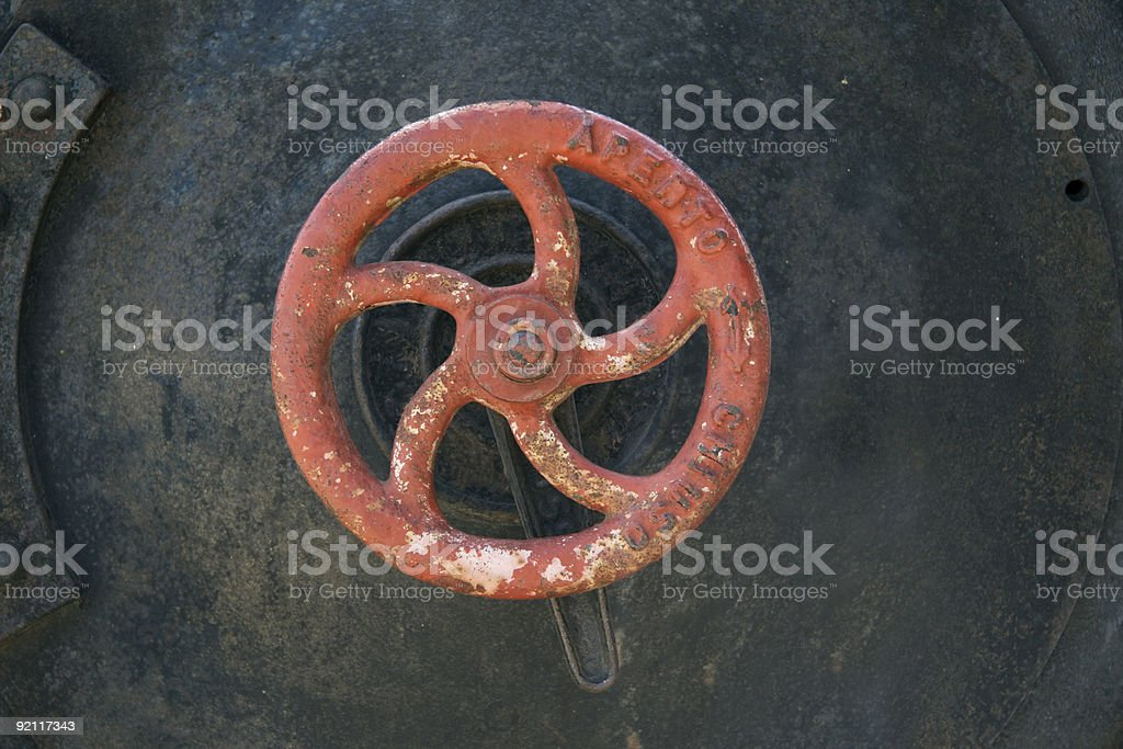 Old red rusty wheel faucet royalty-free stock photo