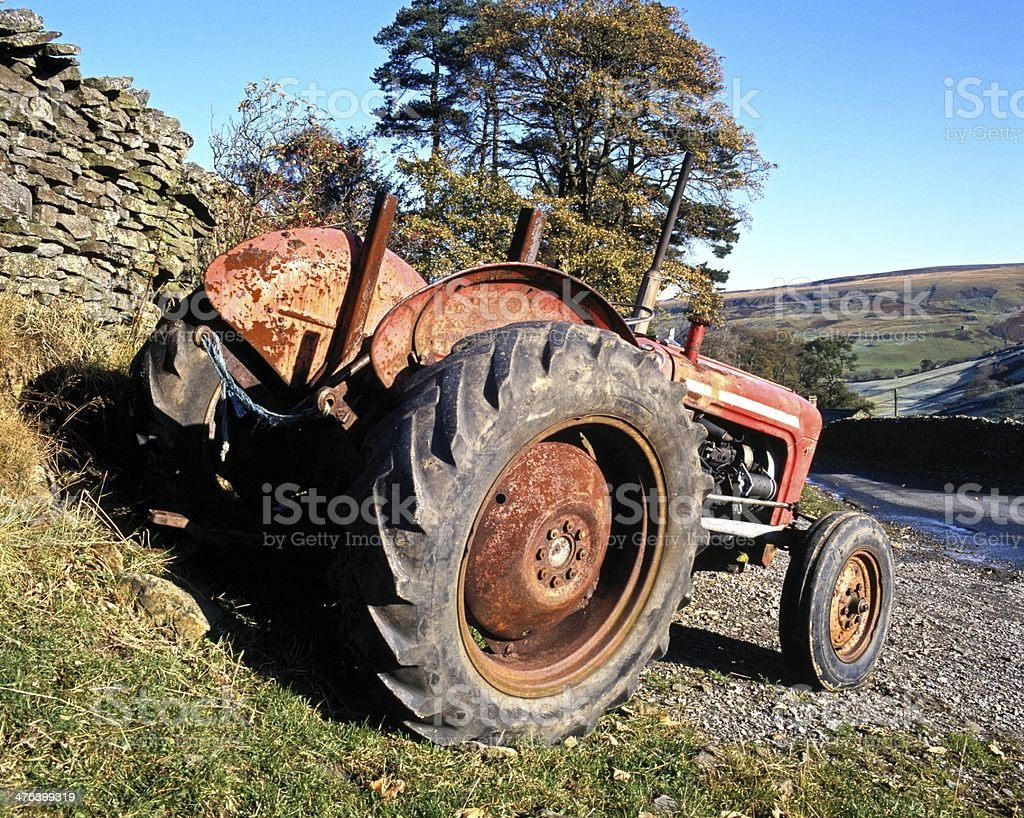 Old red tractor, Yorkshire Dales. stock photo