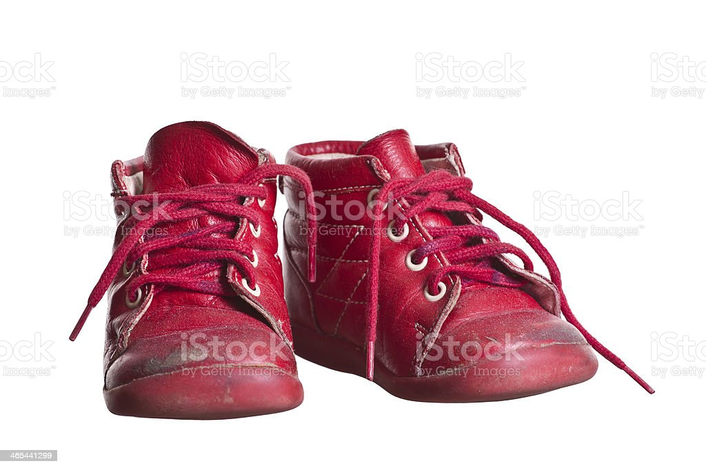 old red used baby shoes stock photo