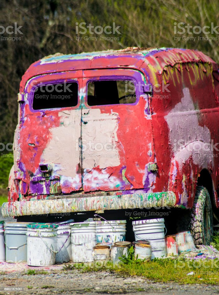 Old red van used as paint wagen is colorful. stock photo