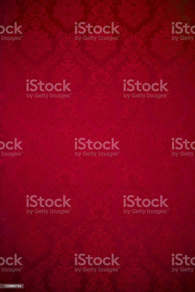 Old red velvet repeating floral wallpaper pattern royalty-free stock photo