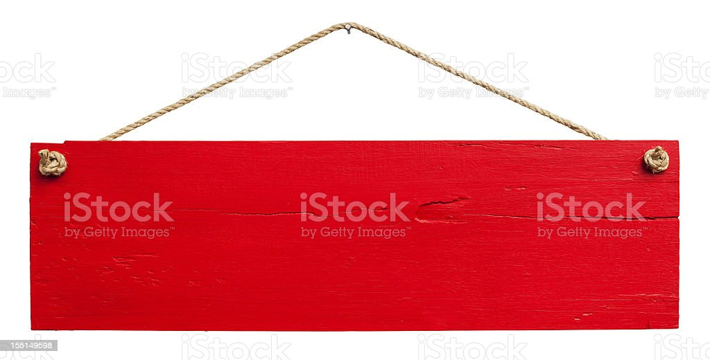 Old red weathered wood signboard. stock photo