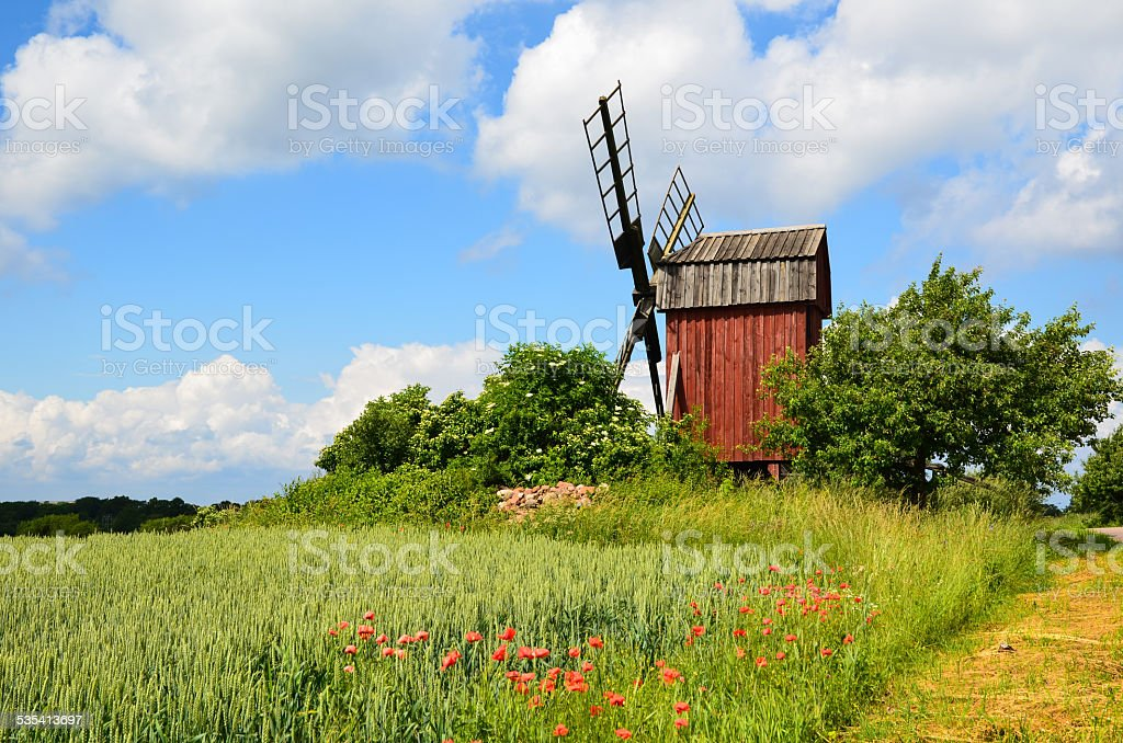 Old red windmill stock photo