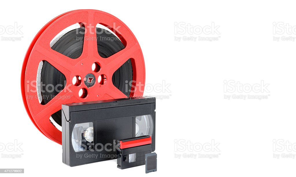 old reel of film, video tape and memory card stock photo