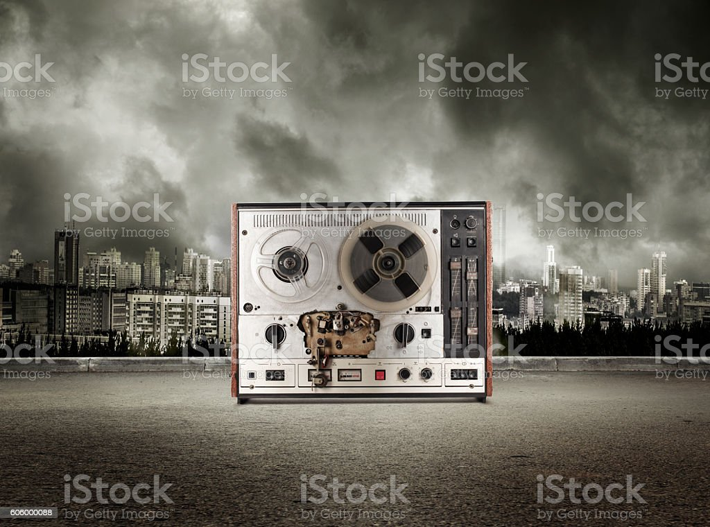 Old reel tape recorder on view of city stock photo