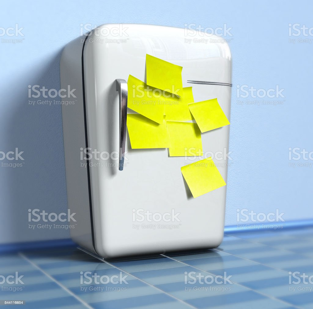 Old refrigerator with yellow stickers stock photo