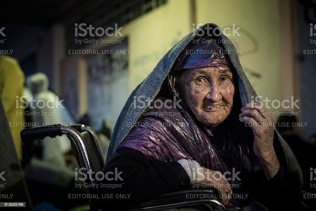 Old refugee woman from Afghanistan on Lesbos, Greece stock photo