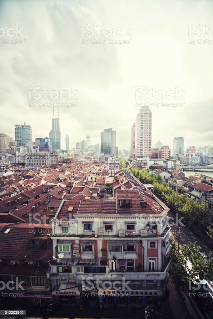 Old residential districts of Shanghai with modern buildings in background stock photo
