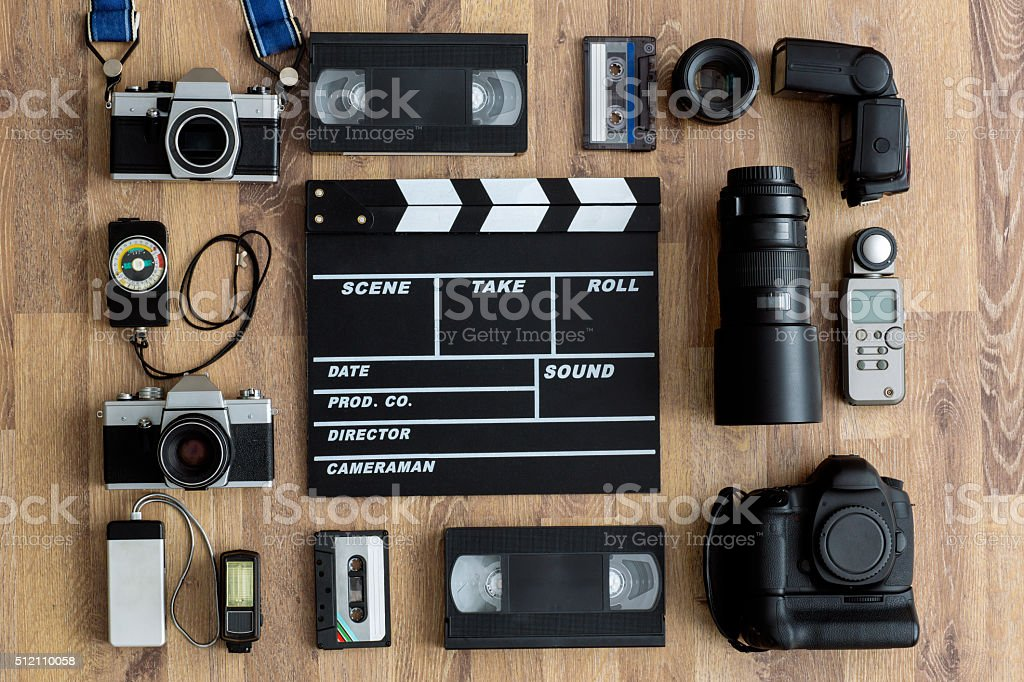Old retro and modern equipment on wooden boards stock photo