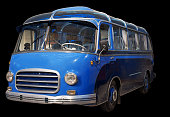 Old retro blue bus. Isolated on black background.