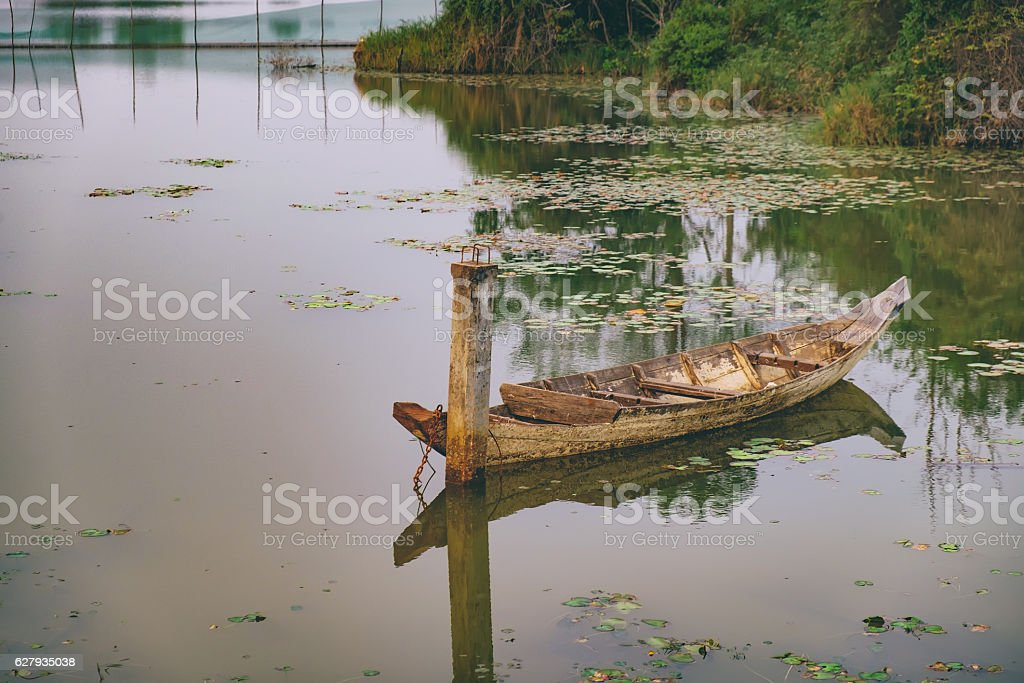 Old retro boat in the water stock photo