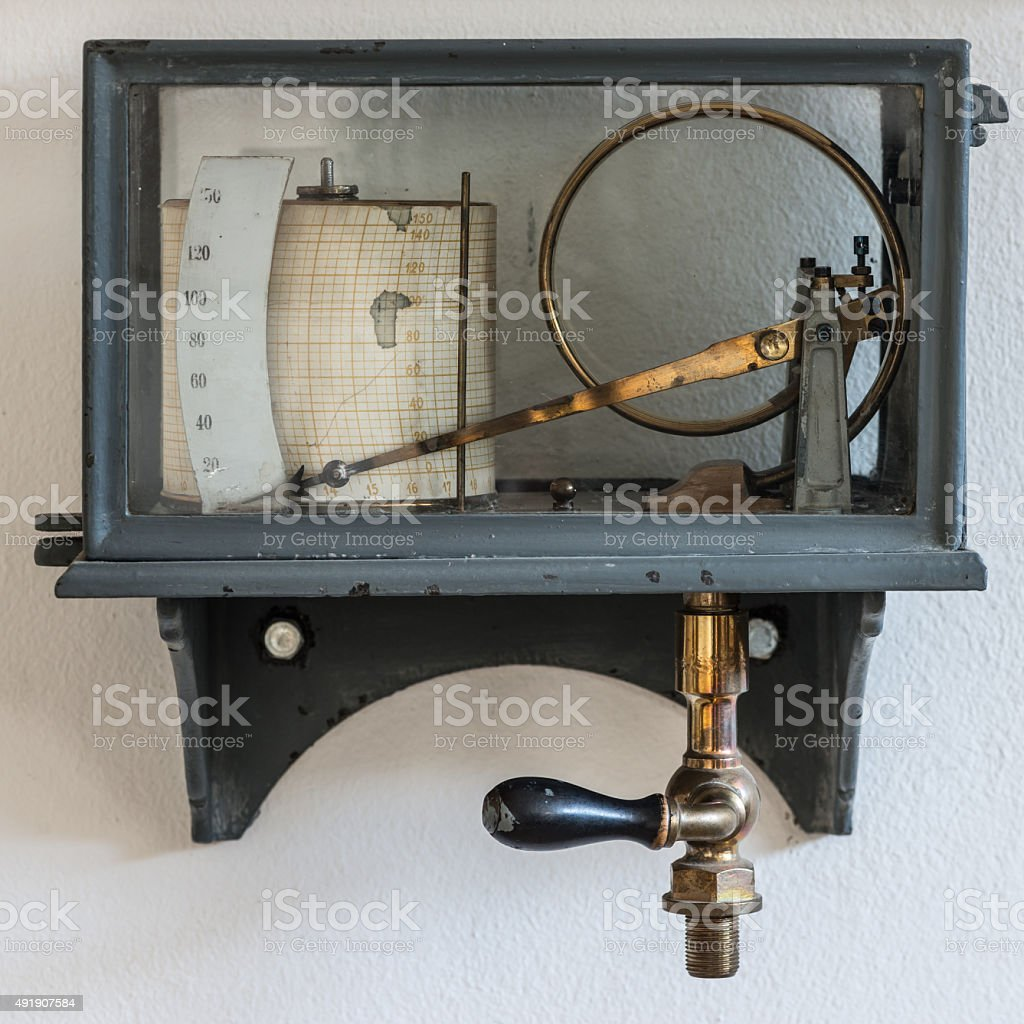 old retro hygrometer weather station at wall stock photo