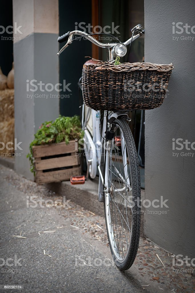 old retro style bicycle leaning on wall stock photo