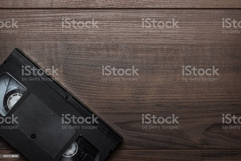 old retro video tape over wooden background stock photo
