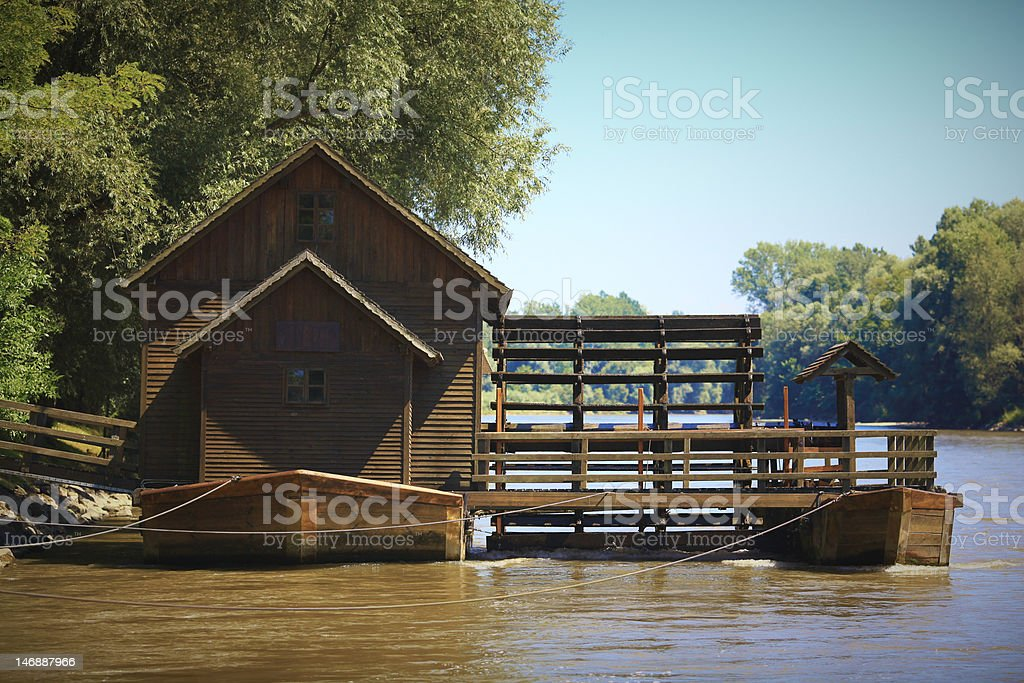 Old river watermill stock photo