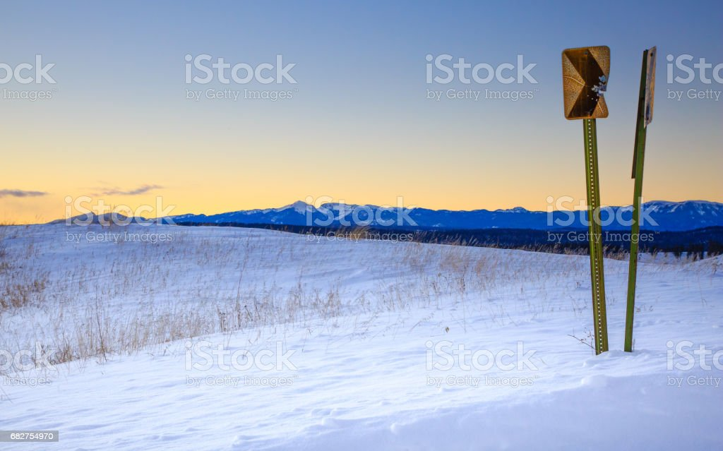 Old road sign in snow stock photo