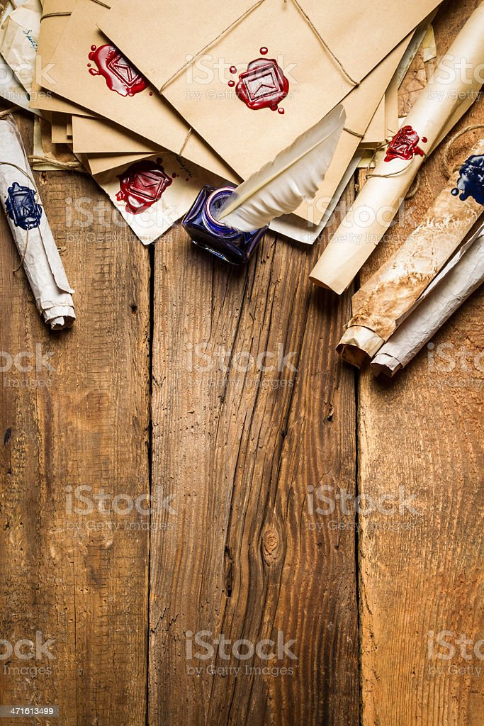 Old rolls of paper and blue ink in the inkwell royalty-free stock photo