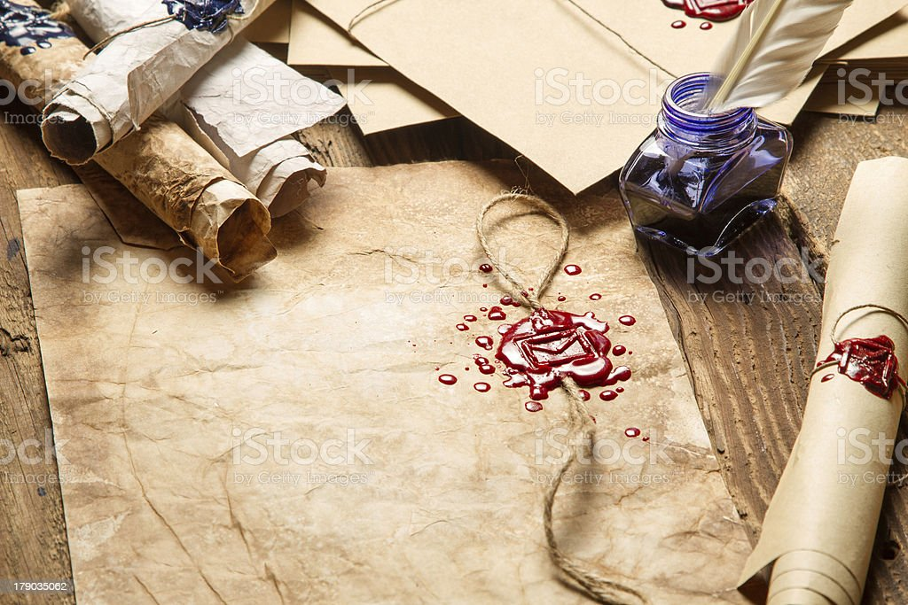 Old rolls of paper, glasses and blue ink royalty-free stock photo