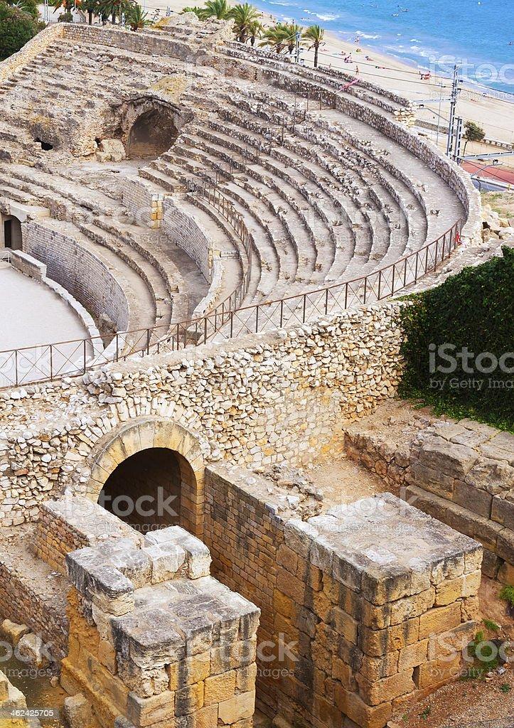 Old Roman amphitheater at Mediterranean stock photo