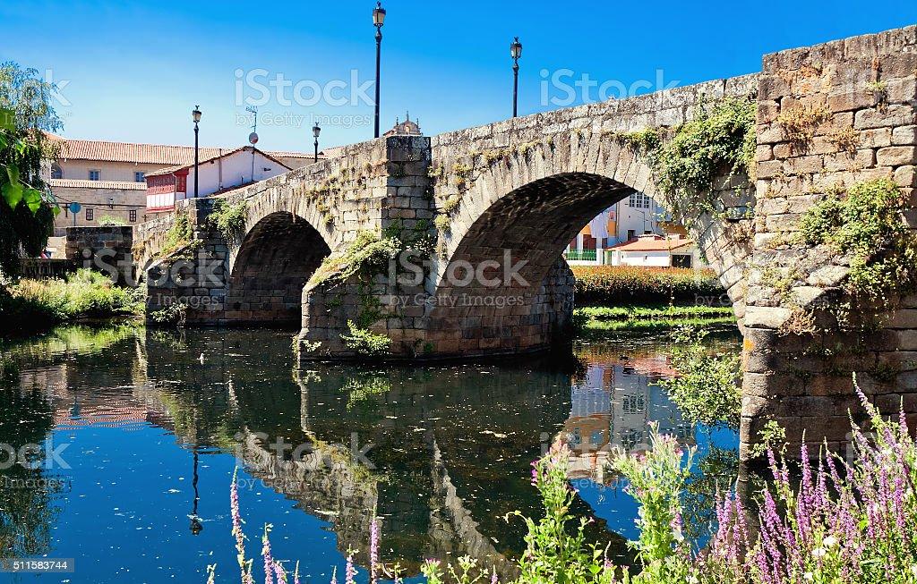 old Roman bridge in Monforte de Lemos, Galicia, Spain stock photo
