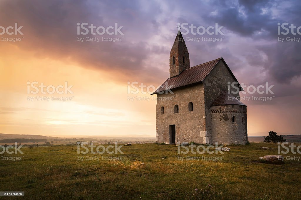 Old Roman Church at Sunset in Drazovce, Slovakia stock photo