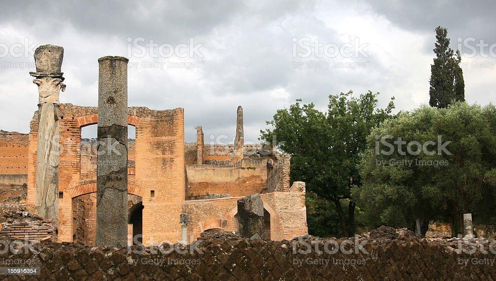 Old Roman Columns and Ruins in villa Adriana stock photo