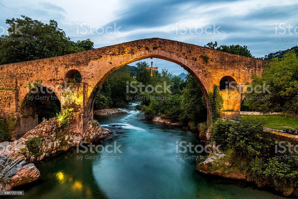 Old Roman stone bridge in Cangas de Onis (Asturias), Spain stock photo