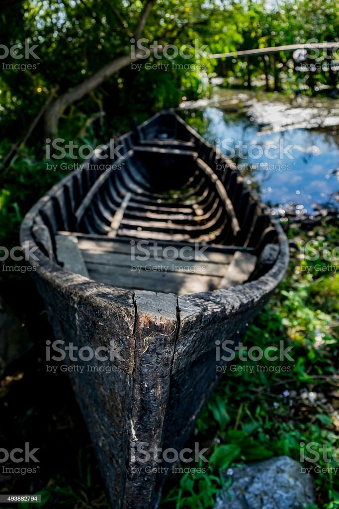 Old romanian traditional boat in Sf. Gheorghe, Danube Delta. stock photo